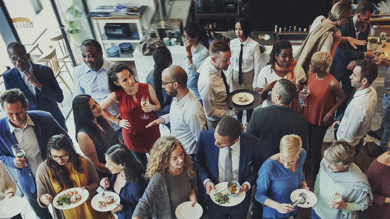 Crowd of people at an event eating