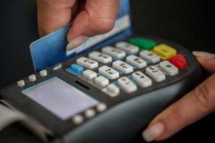 Hand Swiping Credit Card