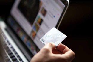 Hand Holding a Debit Card