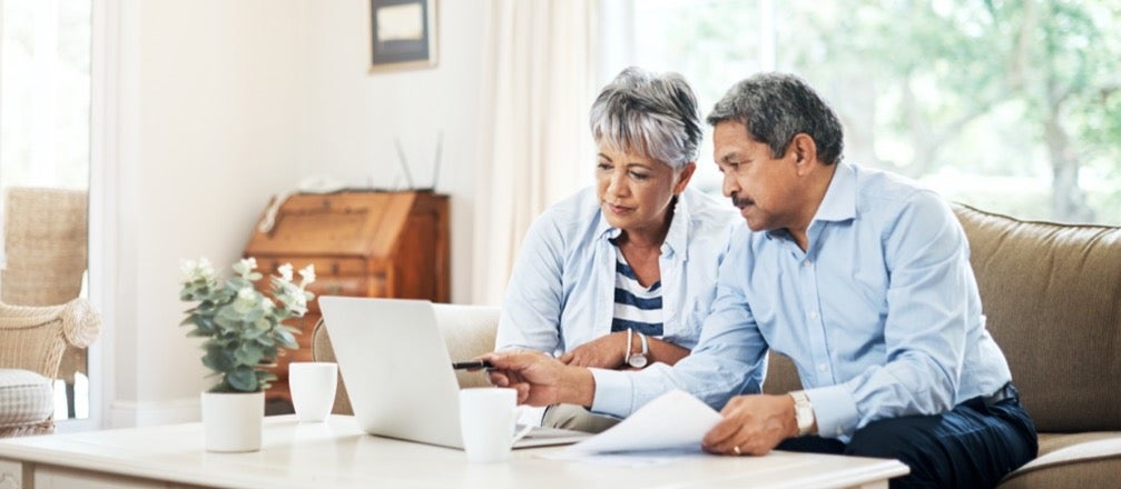 """An elderly couple sits at their couch contemplating the question, """"Does opening a CD affect my credit rating?"""""""