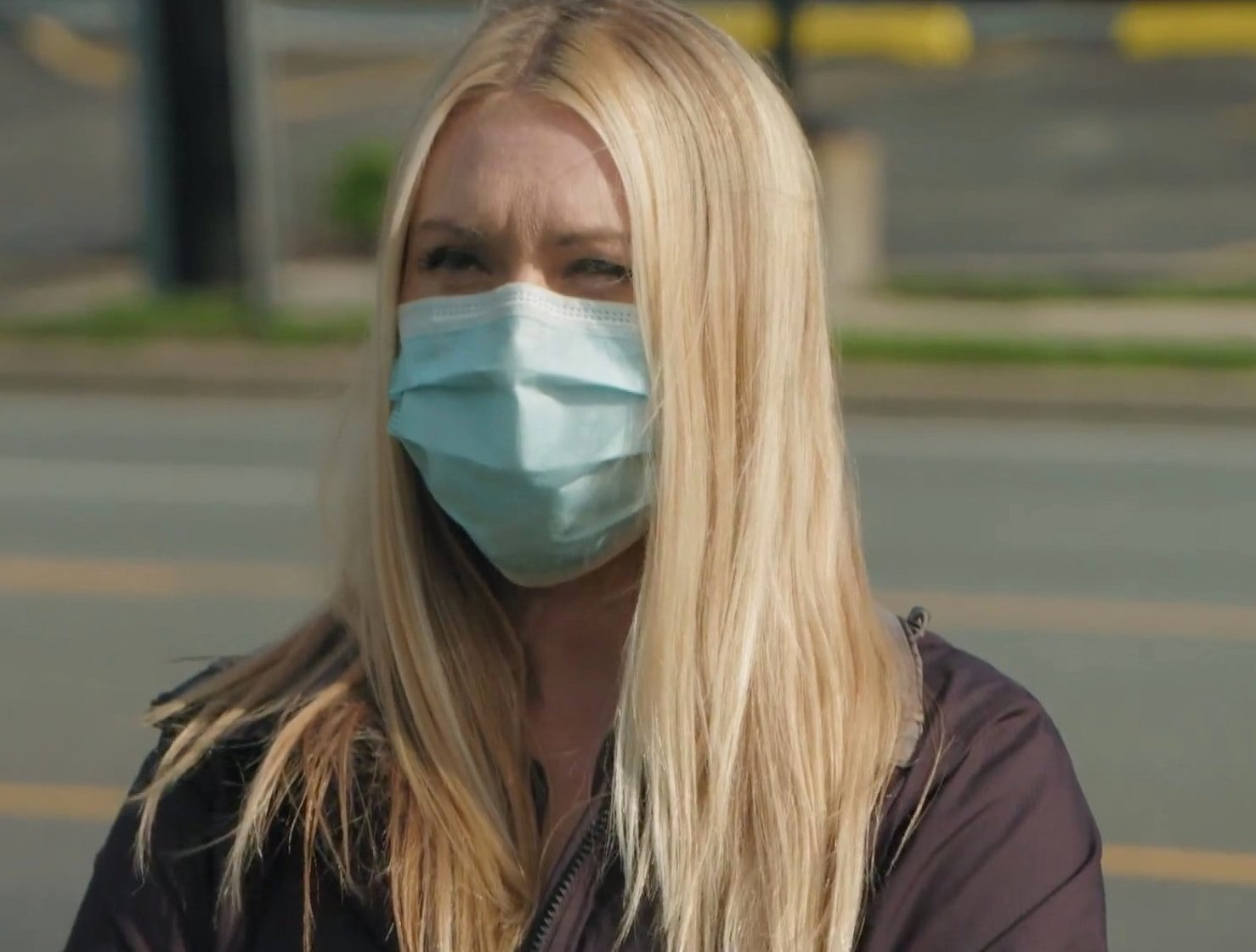Powers wore a mask as she prepared to meet the landlord at the hotel