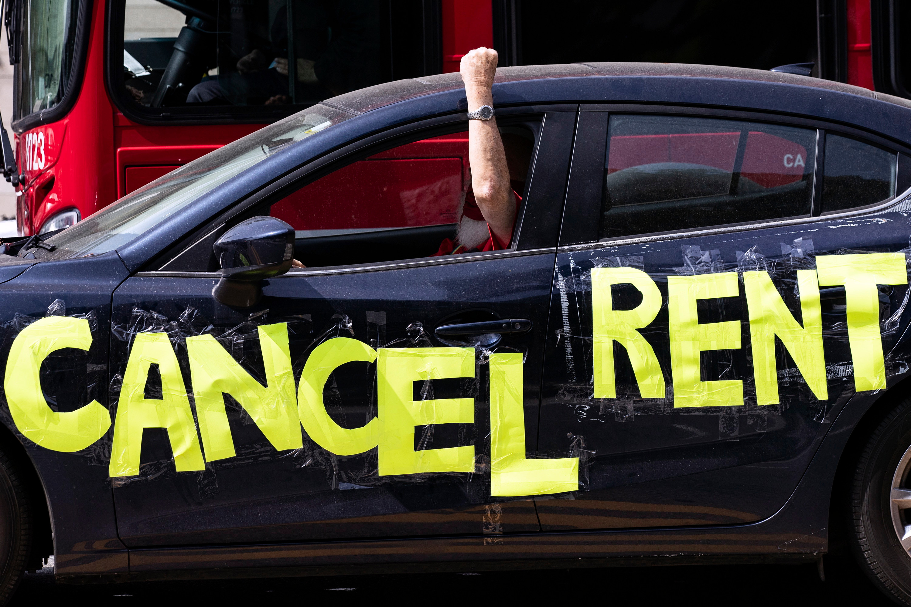 A protester in Los Angeles has the words 'CANCEL RENT' on his car during a protest