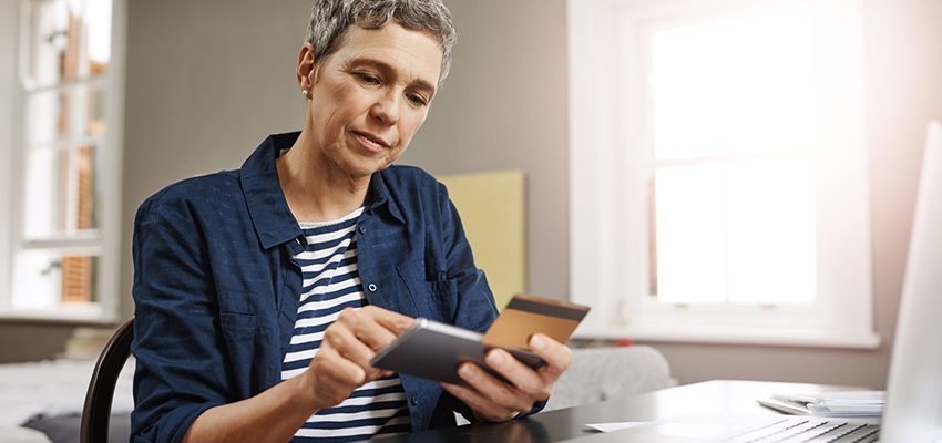 older woman making credit card payment