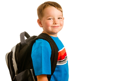 A little boy with a backpack on smiling