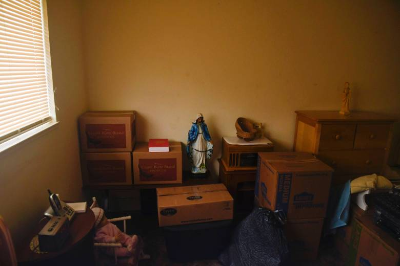 Stacked boxes full of belongings fill the cramped bedroom of Martinez's apartment. Aug. 7, 2020. Photo by Ayrton Ostly/The Salinas Californian