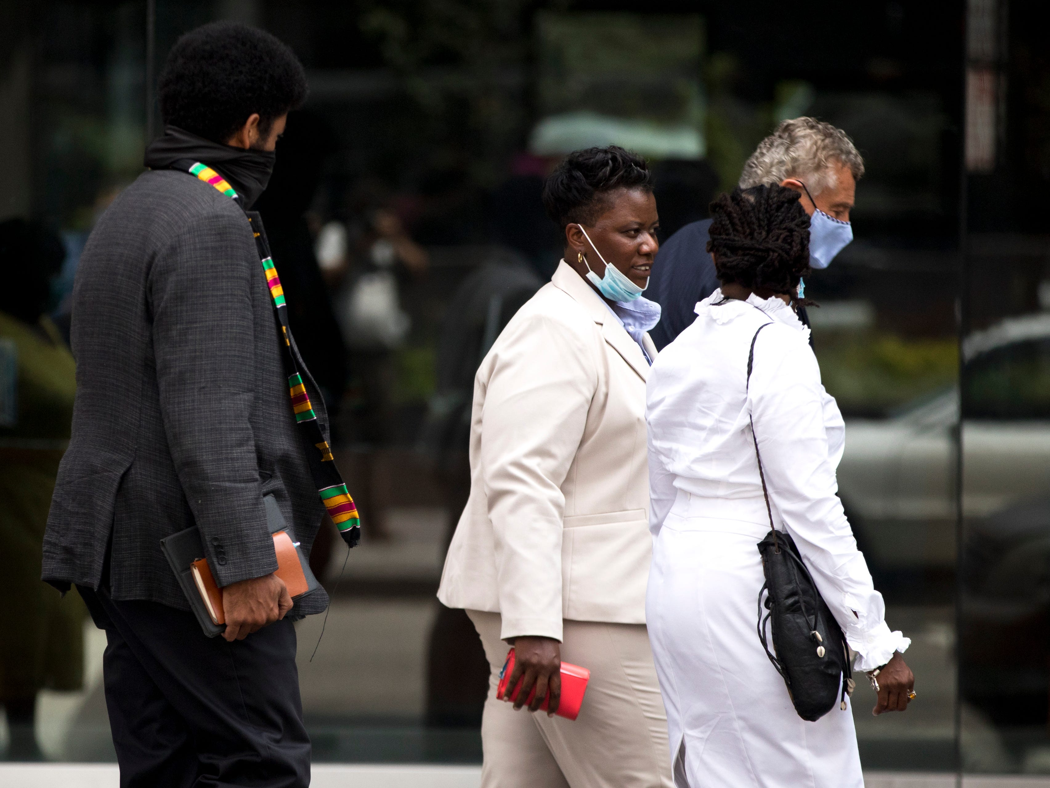 Tamaya Dennard, center, former Cincinnati City Council member, speaks to Iris Roley, Cincinnati activist, as she leaves the federal courthouse in Cincinnati on Monday, June 29, 2020. Tamaya Dennard pleaded guilt to a federal fraud charge.