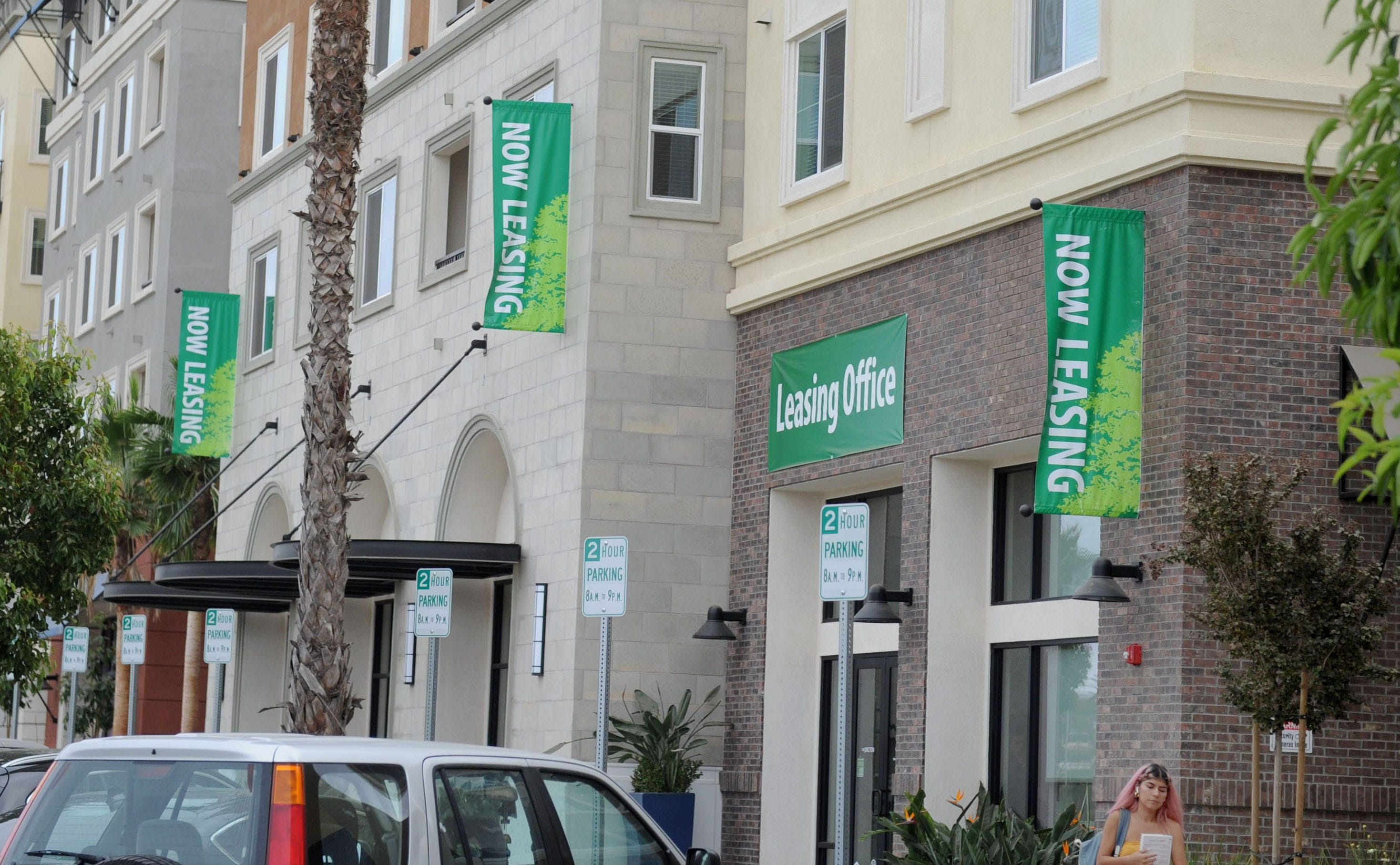 Bright signs advertise apartments for rent in October 2019 at the Wagon Wheel development in north Oxnard.