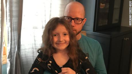 Bryan Clift with his daughter Iyla. Clift has been out of work since March and is behind on rent on his apartment in the suburbs of Minneapolis.