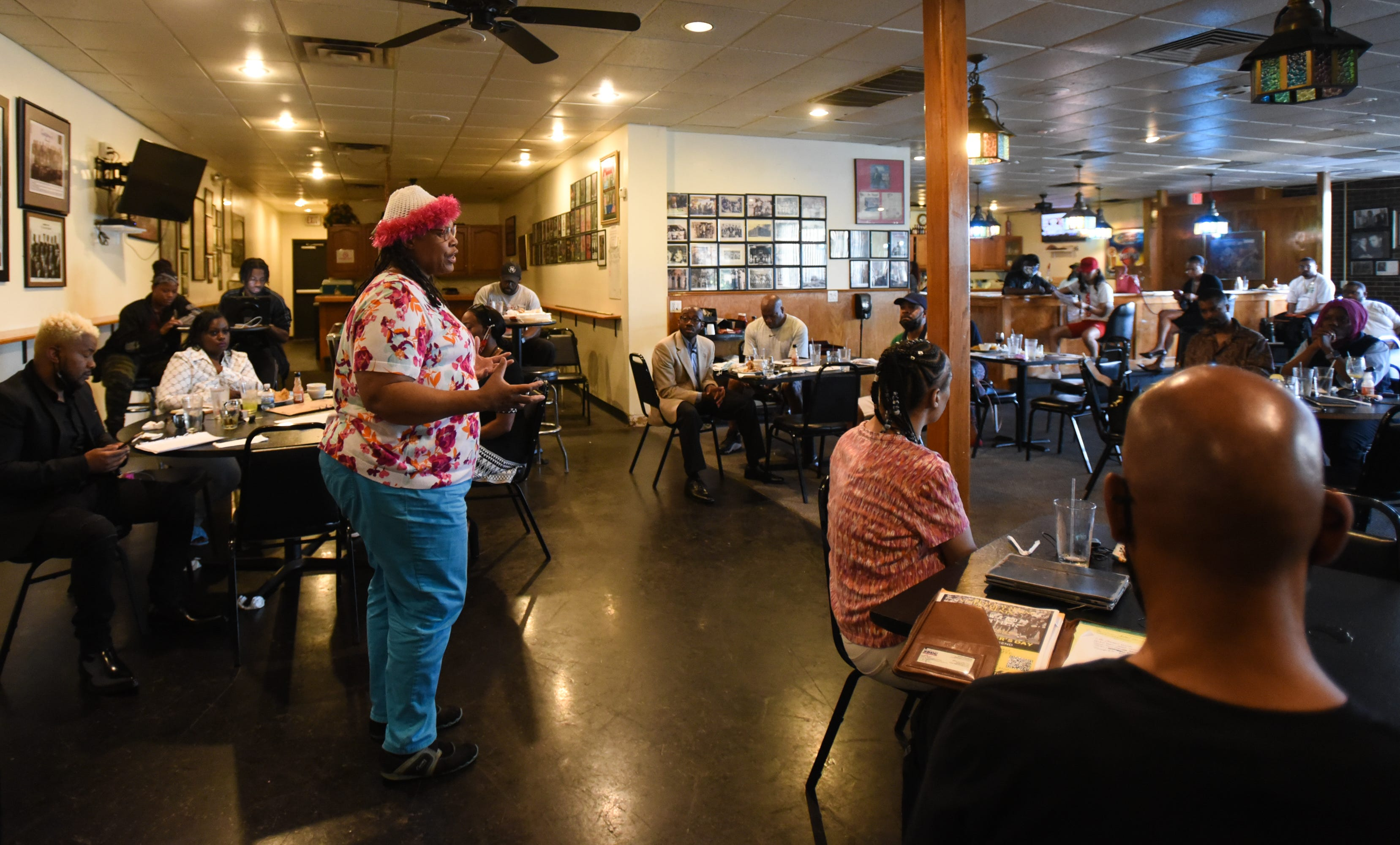 """Joy Gleason of GLAD Tours talks about her business during Black Wall Street of Lansing's """"Black Think Tank"""" event at Gregory's."""